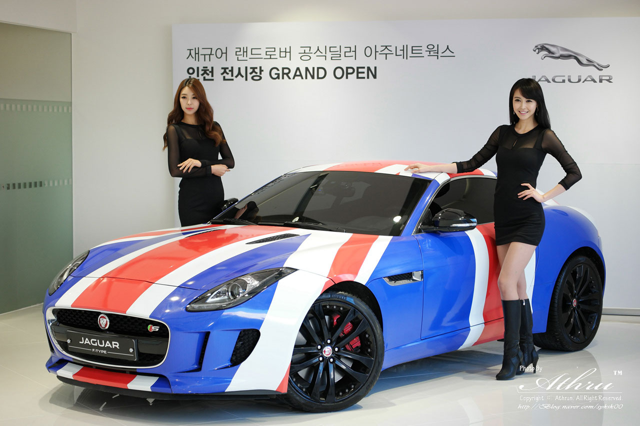 Korean models Kang Yui and Kim Hyun Jung at an opening event for a ...